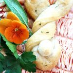 CUTE BUNNY BREADSTICK ON A PLATE WITH HERBS AND FLOWERS