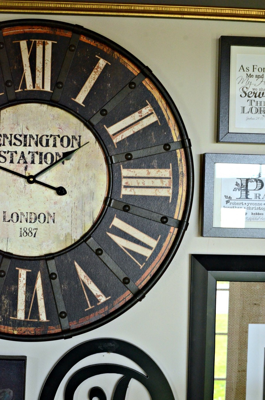 ADDING A CLOCK TO WALL ART GALLERY- Make a big statement with a big clock-stonegableblog.com