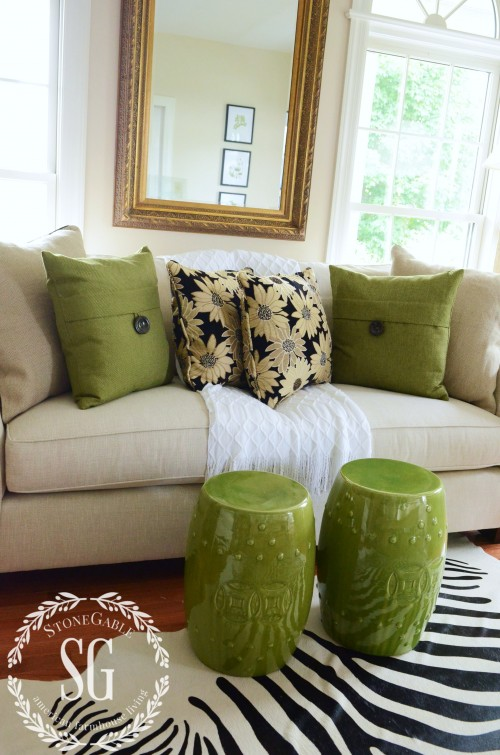 nuetral pillows with black and white floral pillows