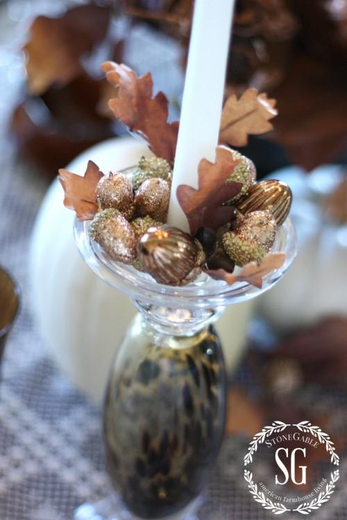 adding acorns to candlesticks-stonegableblog
