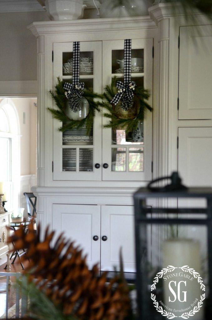 CHRISTMAS FARMHOUSE KITCHEN-pine wreaths-glass cabinets-stonegableblog.com