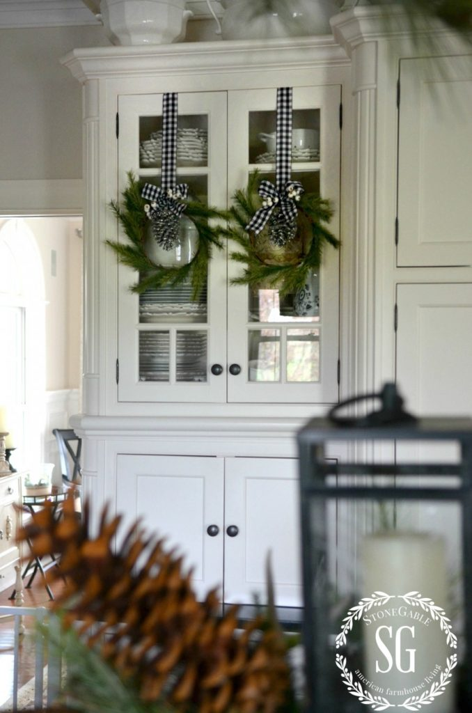 CHRISTMAS FARMHOUSE KITCHEN-pine wreaths-glass cabinets-stonegableblog.com