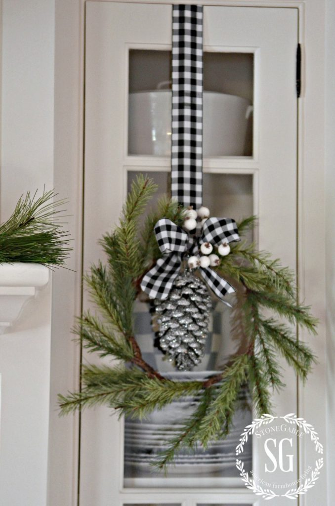CHRISTMAS FARMHOUSE KITCHEN-pine wreaths-glass from cabinets-stonegableblog.com