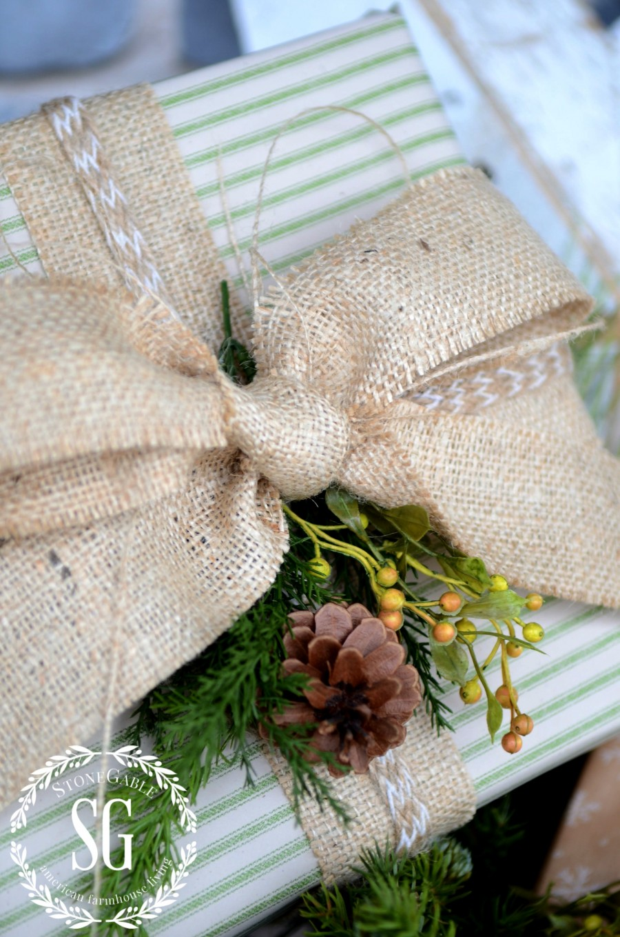 CHRISTMAS GIFT WRAP-burlap bow and greens-stonegableblog.com