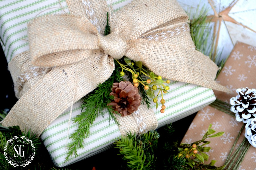 CHRISTMAS GIFT WRAP-ribbon and greens on a package-stonegableblog.com