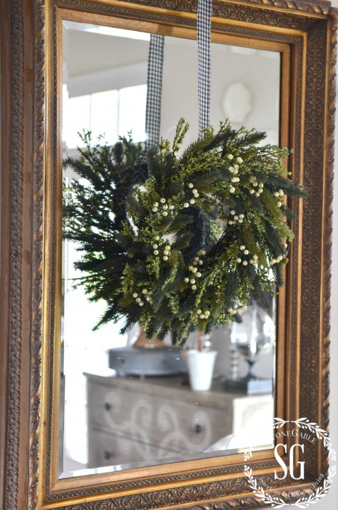 CREATIVE WAYS TO USE CHRISTMAS WREATHS-wreath hanging on mirror-stonegableblog.com