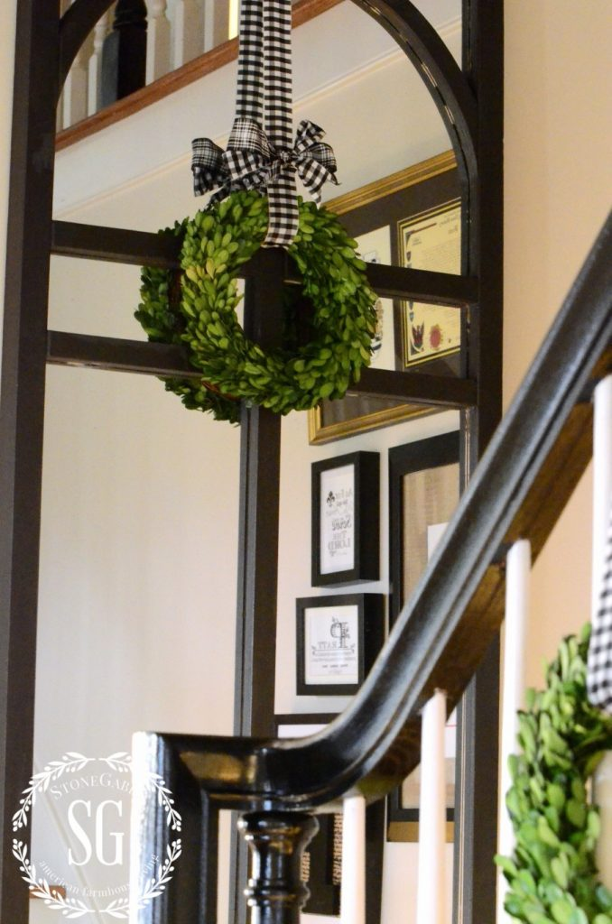 CREATIVE WAYS TO USE CHRISTMAS WREATHS-wreath on mirror and stairs-stonegableblog.com