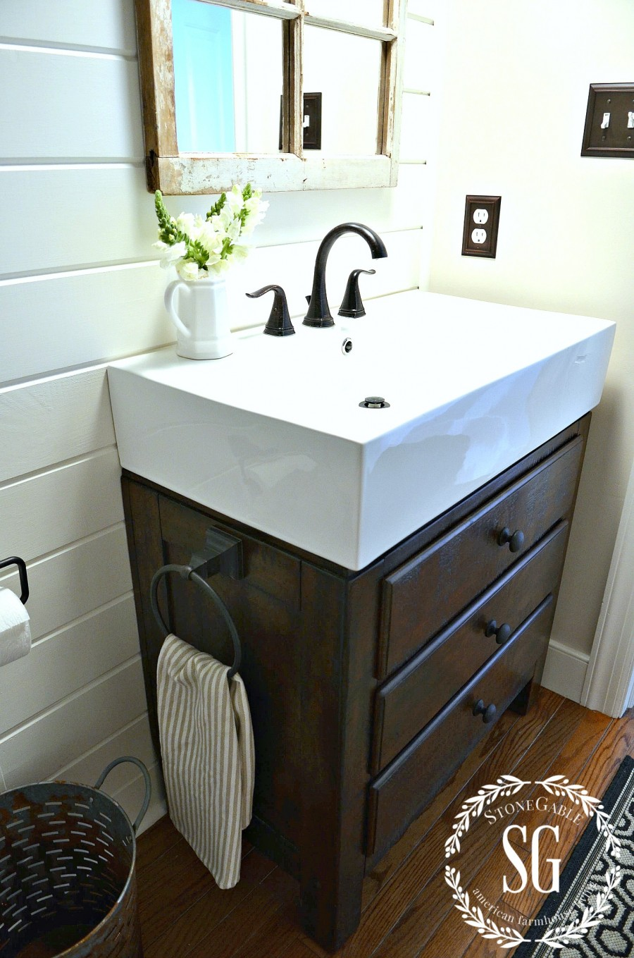Nothing is more farmhouse than a plank wall and large trough sink in the bathroom.  This powder room from Stone Gable Blog is perfectly styled.  | Friday Favorites at www.andersonandgrant.com