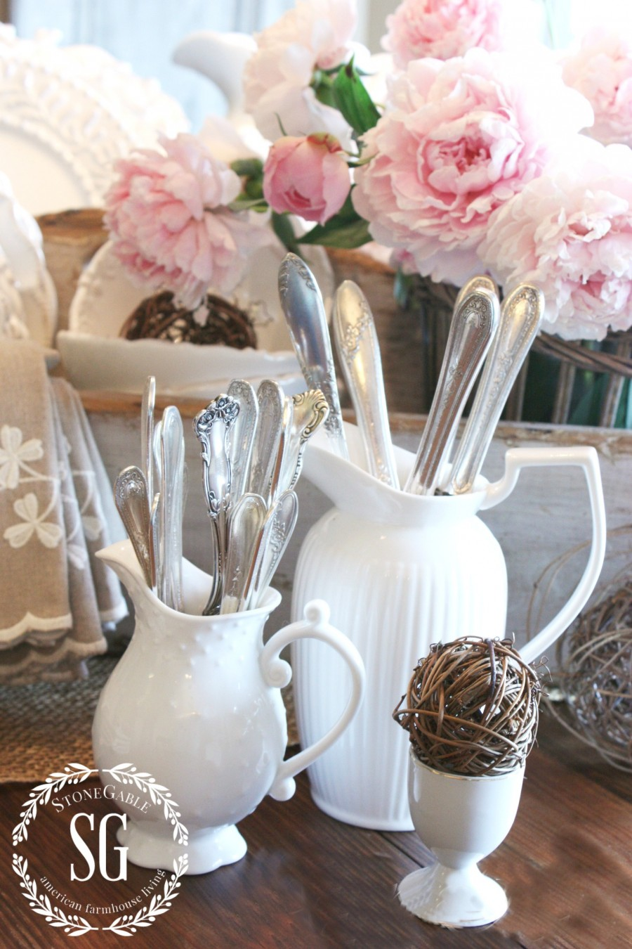 5 GREAT USES FOR PITCHERS... FARMHOUSE STYLE-silver in white pitchers-stonegableblog.com