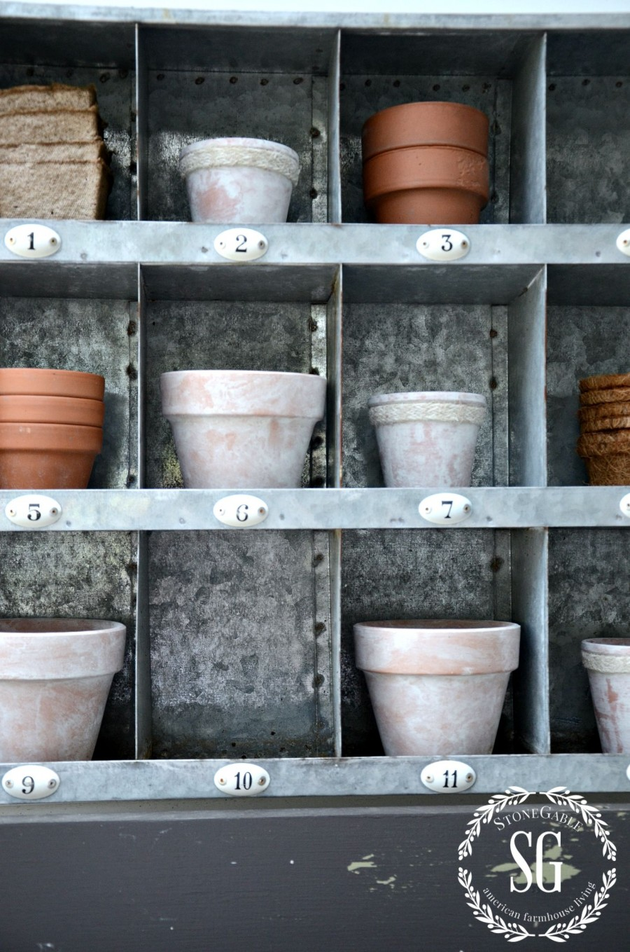 AGING TERRACOTTA POTS WITH PAINT- aged pots in galvanized cubby-stonegableblog.com