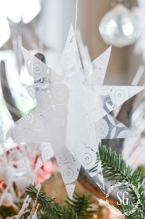 REINDEER CENTERPIECE- Table centerpiece with greens and paper stars.