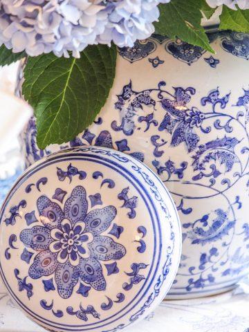 blue and white decor ginger jar holding blue hydrangeas