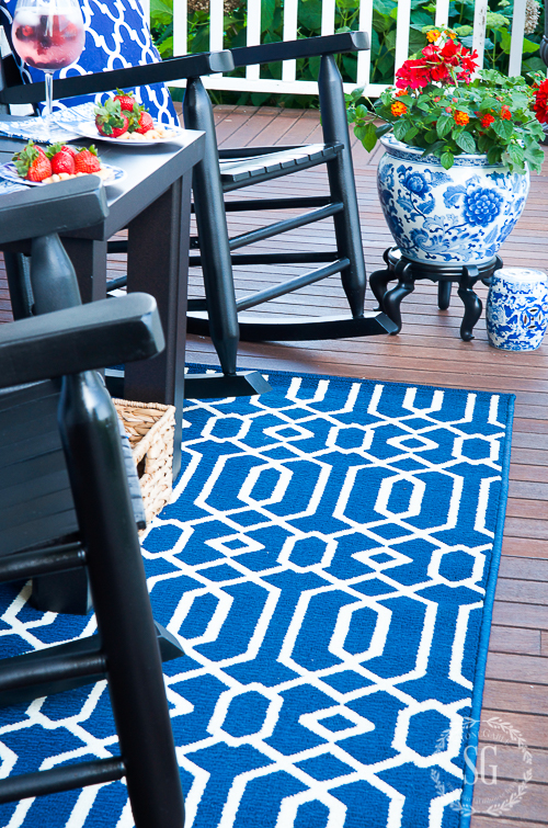 I did get new indoor/outdoor carpets for the front porch (Ballard Designs) in a bold royal blue and white.  I used the inspiration of the blue and white planter to decide on this color and style.
