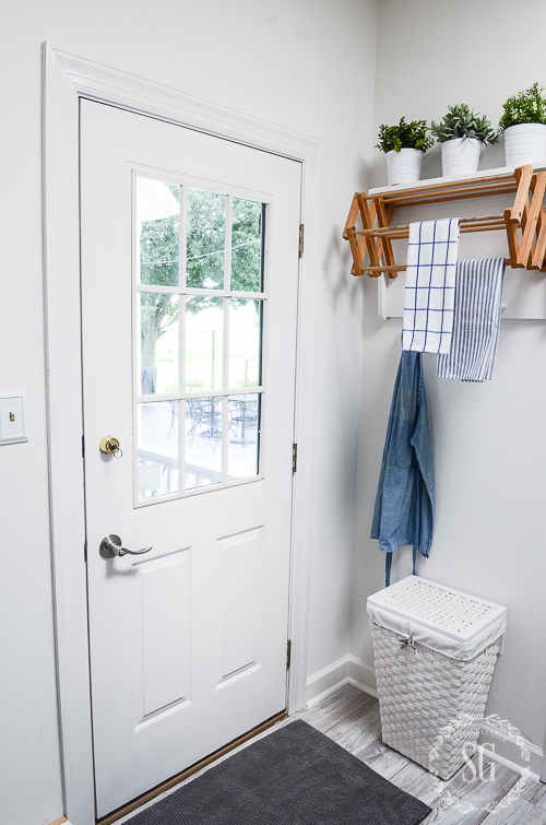 FUNCTIONAL AND FABULOUS FARMHOUSE LAUNDRY ROOM REVEAL-How to make a crisp, clean and fabulous laundry room on a tight budget!