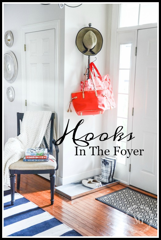 HOOKS IN THE FOYER-Create a space for guest to hang coats, purses and other thing on.