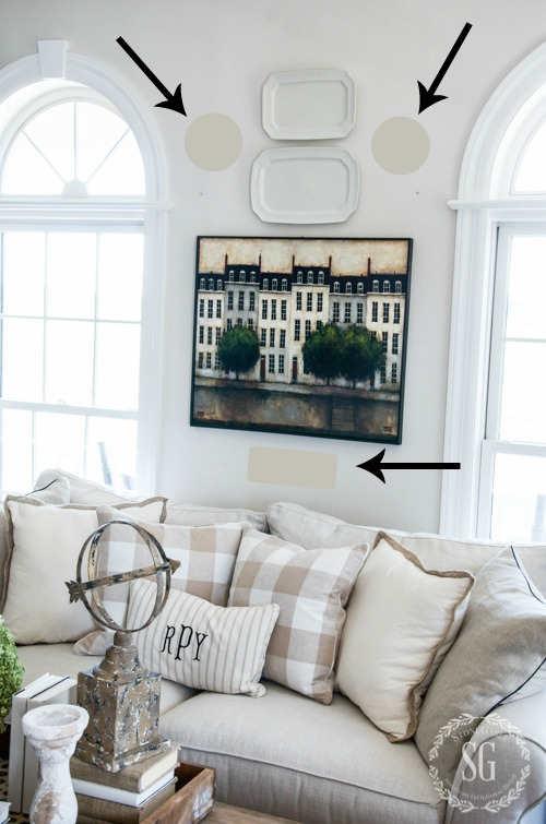HOW TO MAKE A SMALL PIECE OF ART LOOK BIGGER- Here are some easy fixes and tips for creating a beautiful wall gallery centered around a piece of art