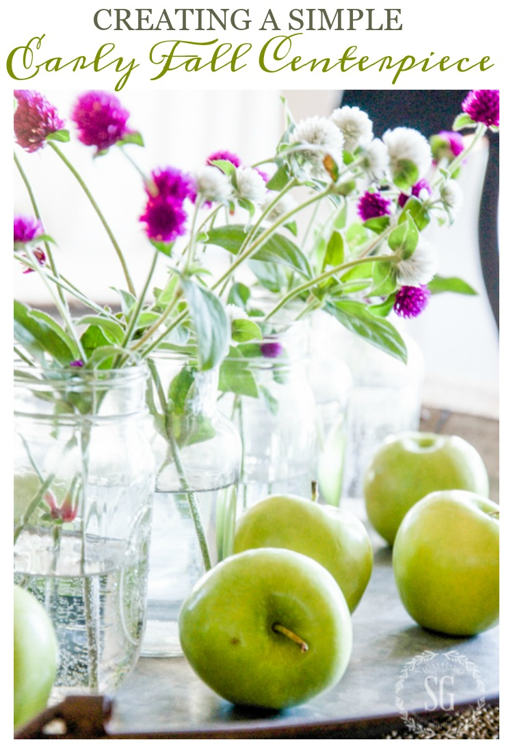 early fall centerpiece made with green apples on a galvanized tray