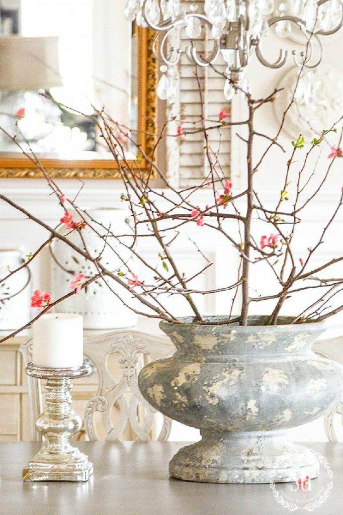 FLOWERING BRANCHES IN A BIG URN