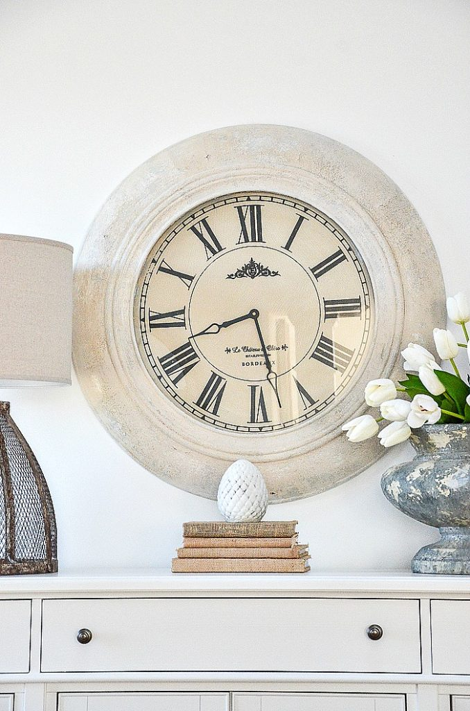 large white painted clock