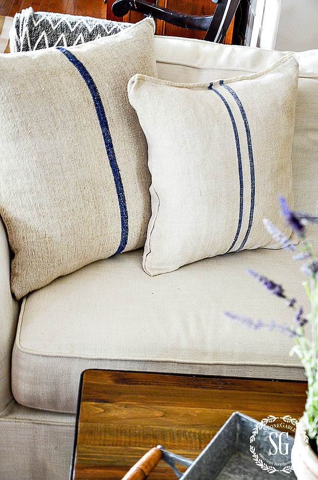 EASY TO MAKE GRAIN SACK PILLOW DIY- You can make this pillow in less than 30 minutes!
