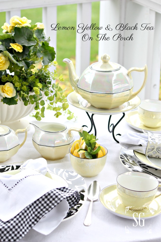 LEMON YELLOW AND BLACK TEA ON THE PORCH-A pretty formal summer tea on the back porch.