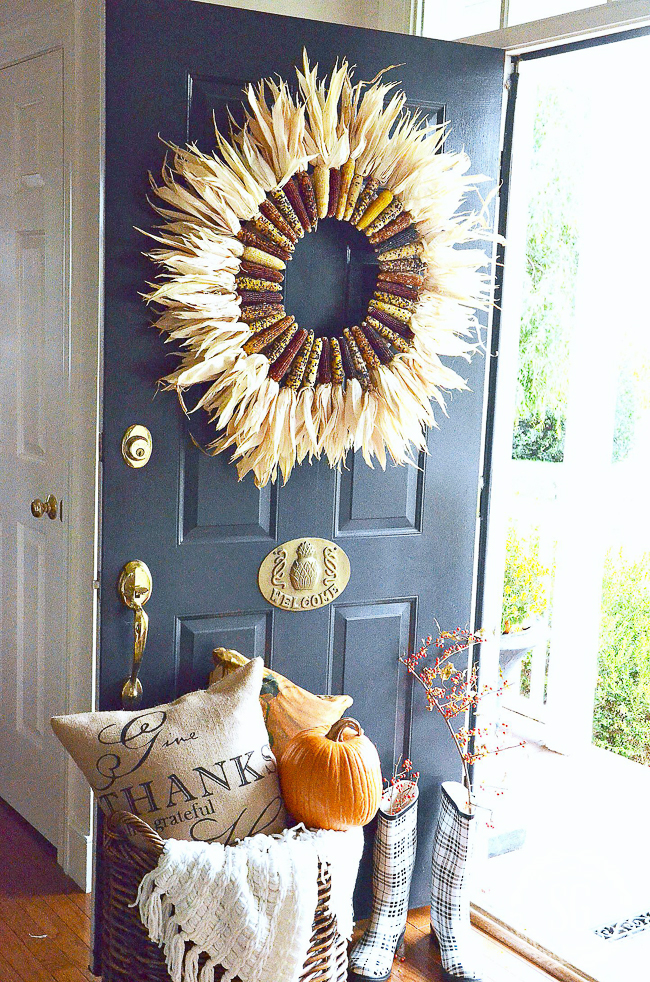 FALL WREATH ON AN OPEN FRONT DOOR