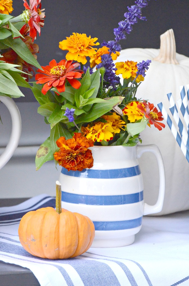garden fall flowers in a blue and white pitcher on a beautiful fall table
