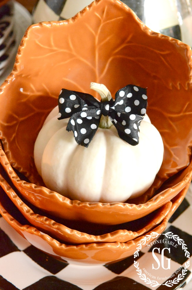 orange dishes with white pumpkins in them