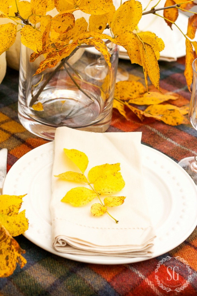 gold leaved on top of a neutral linen napkin
