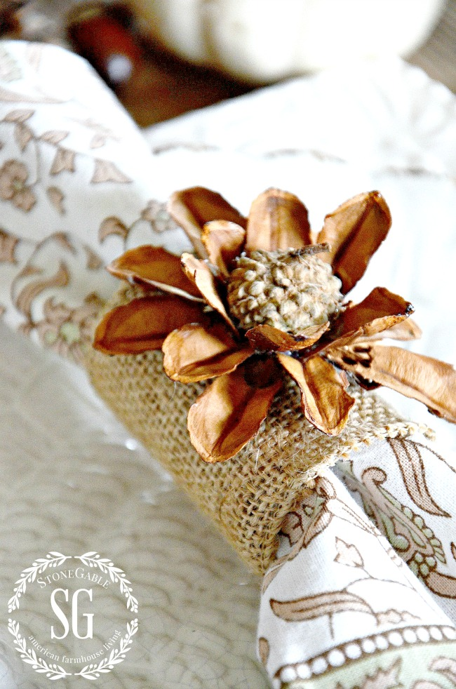 acorn and pinecone flower napkin ring on a beautiful fall table