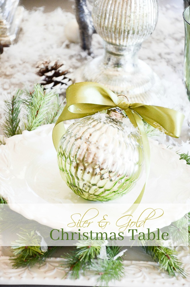 SILVER AND GOLD CHRISTMAS TABLE- A fantasy of a table filled with snow, silver, gold and touches of Christmas green.