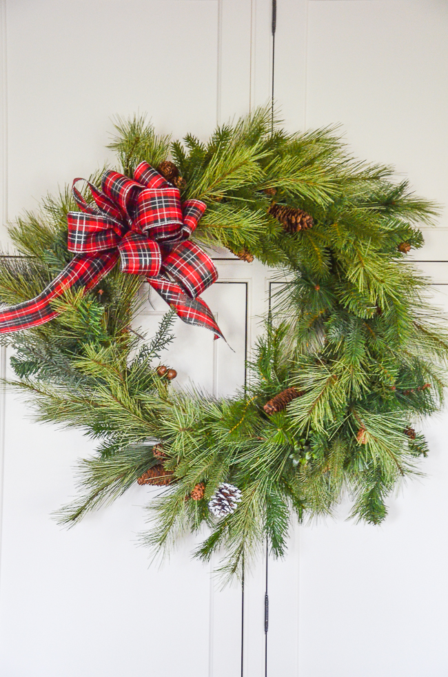 wreath with a read plaid bow