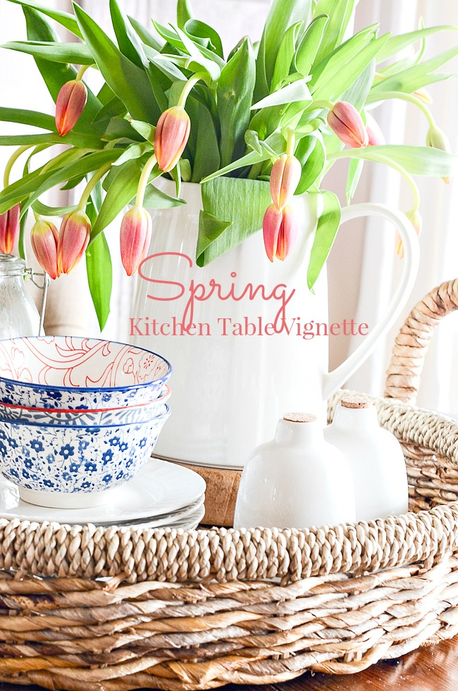 SPRING KITCHEN TABLE VIGNETTE- Add a sweet vignette to your kitchen table full of pretty dishes and a pitcher of glorious tulips! It will brighten up your whole kitchen