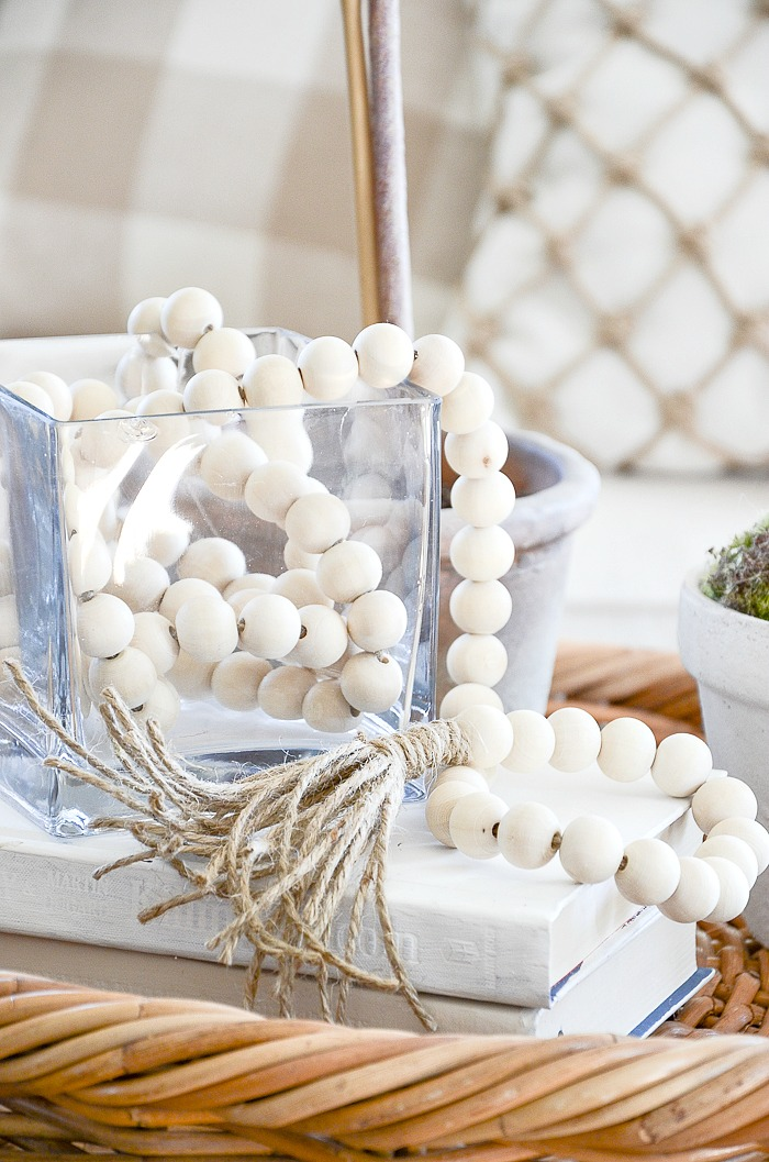 WOOD BEAD GARLAND- These gorgeous bead garlands are so hot right now and no wonder. They add a chic punch to any decor. You can make one for under $9.00!