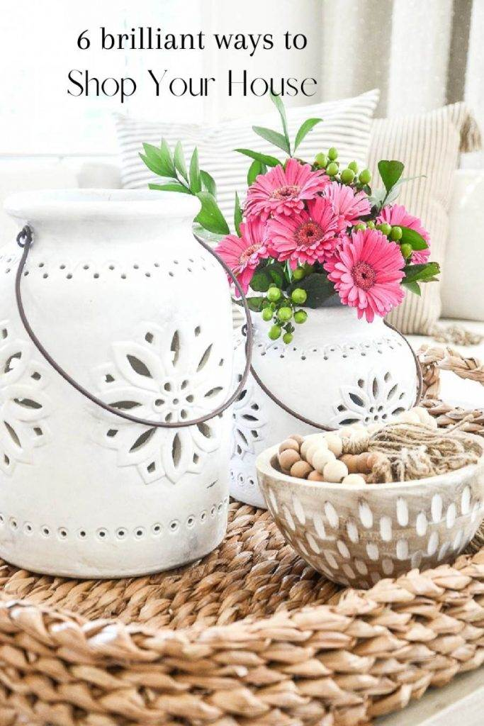 LANTERNS IN A BASKET WITH PINK FLOWERS