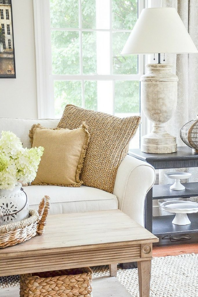 adding light colored texture like the woven paper pillow on the sofa is an easy way to decorate for spring after easter