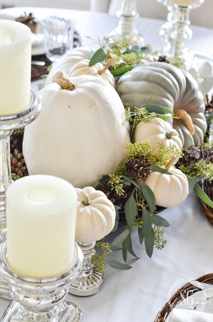 pumpkin, seeded eucalyptus and pinecone centerpiece