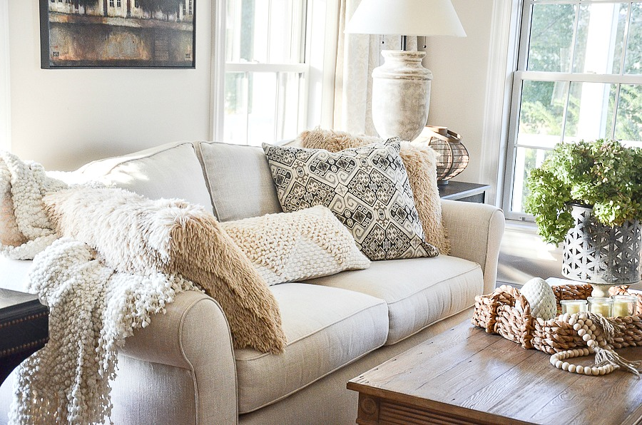4 neutral pillows on sofa