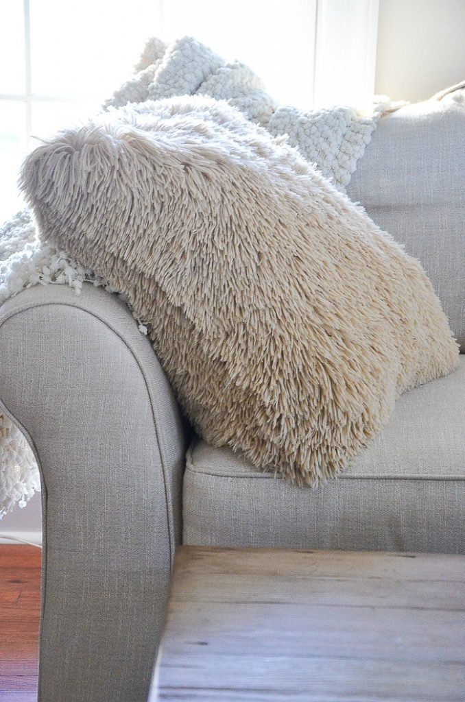 large shaggy pillow on sofa