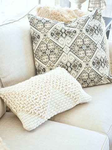 neutral pillows on sofa