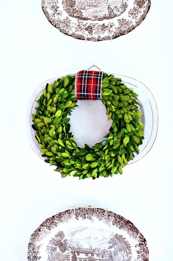 WREATH ON A PLATE ON A WALL