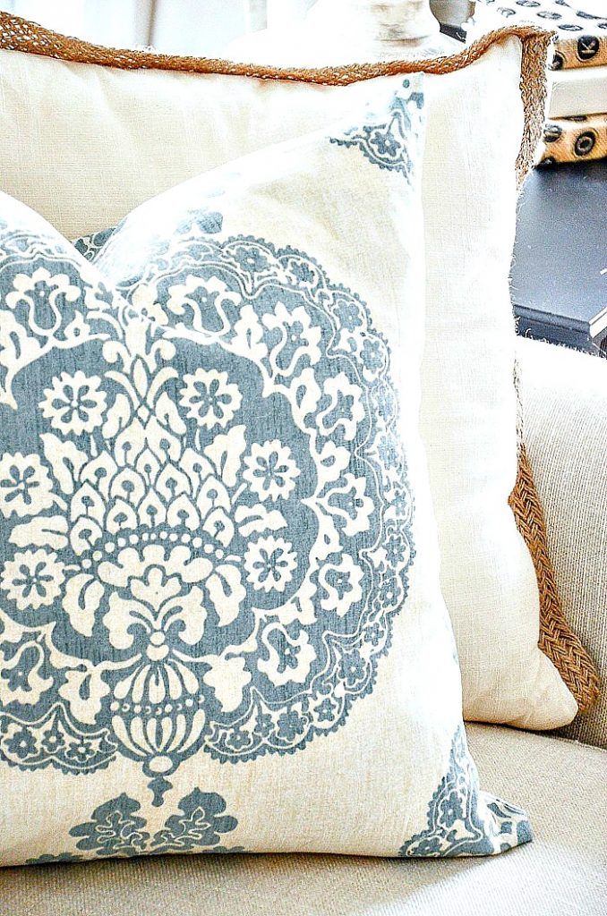 close up of a blue and white spring inspired pillow
