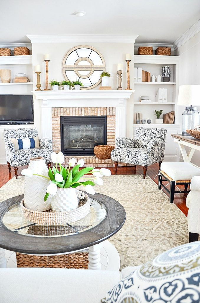 best decorating tip- family room fireplace with chairs on either side