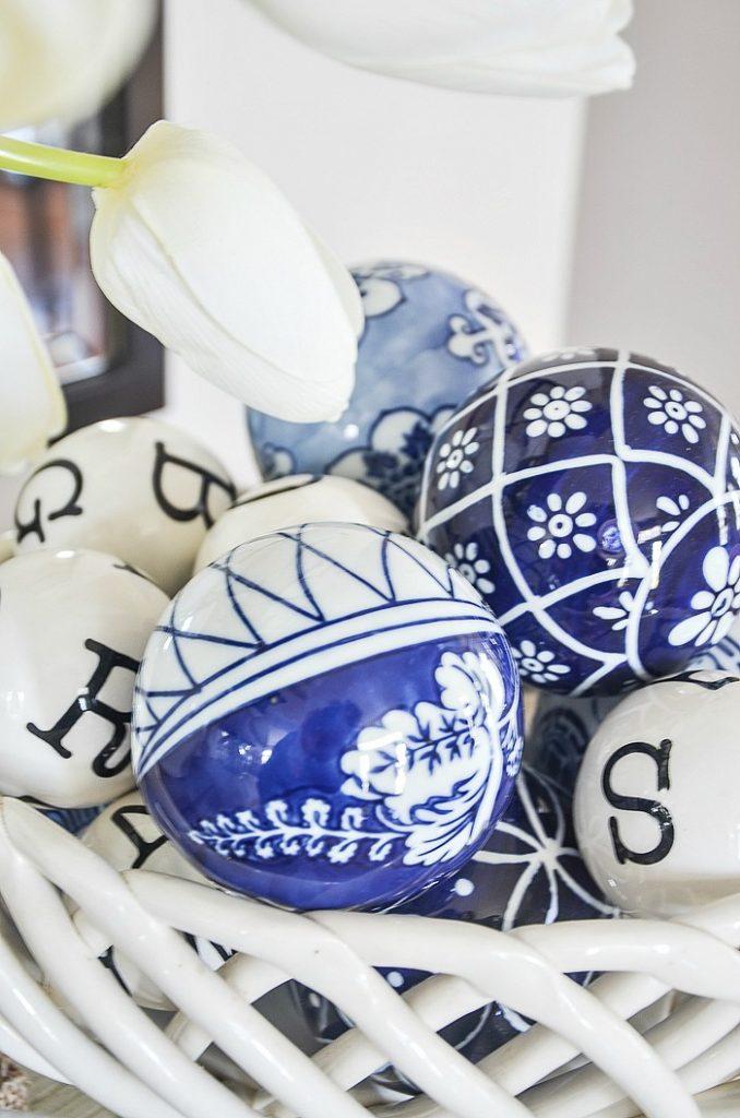 trendy porcelain balls in a basket