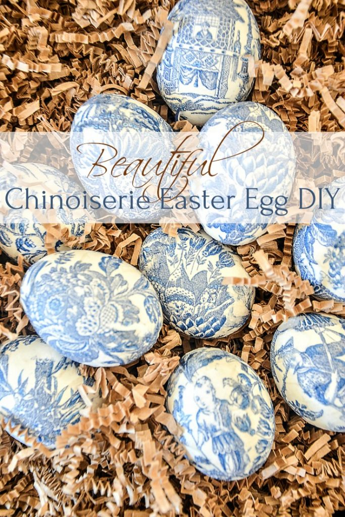chinoiserie easter eggs with Oriental design in a crate of brown crinkle paper