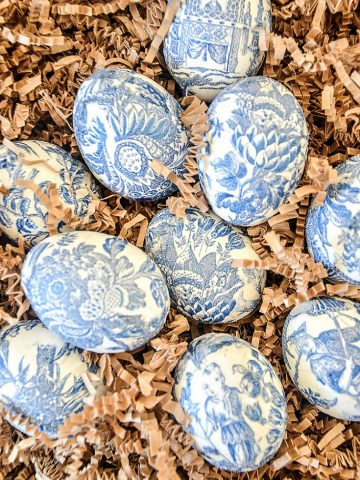 blue and white eggs in crinkle paper