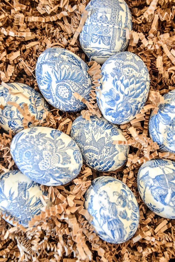 Chinoiserie Easter Eggs on a bed of brown crinkle paper