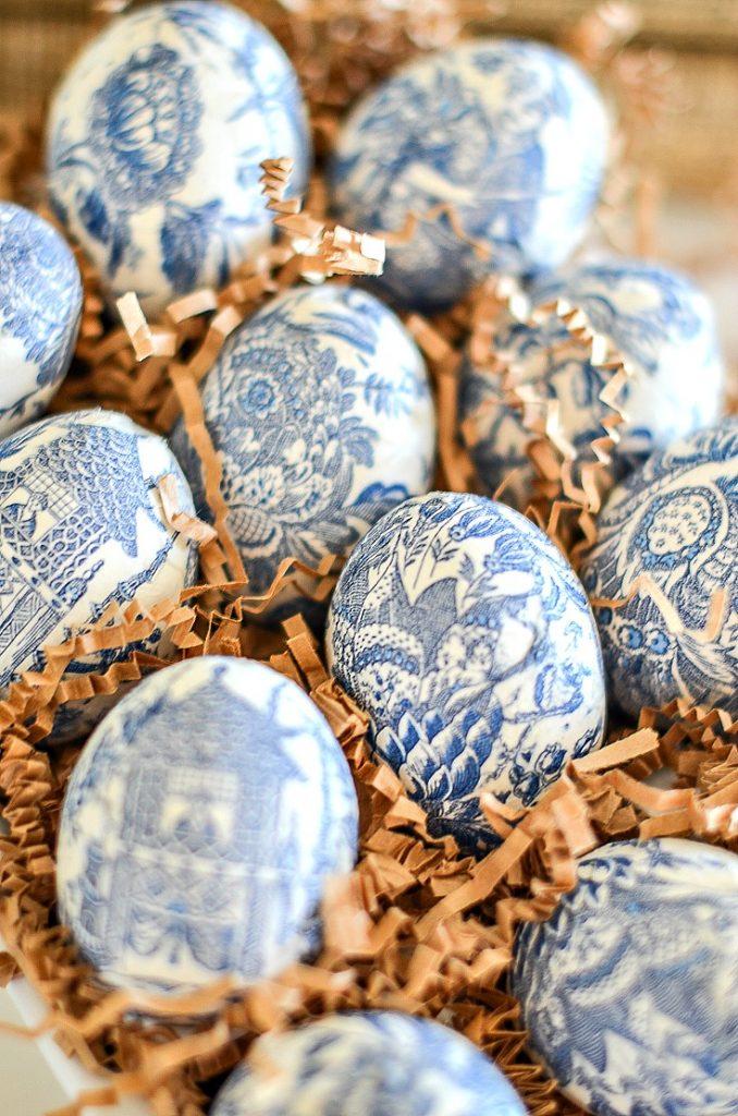 one dozen Easter eggs in a ceramic egg carton