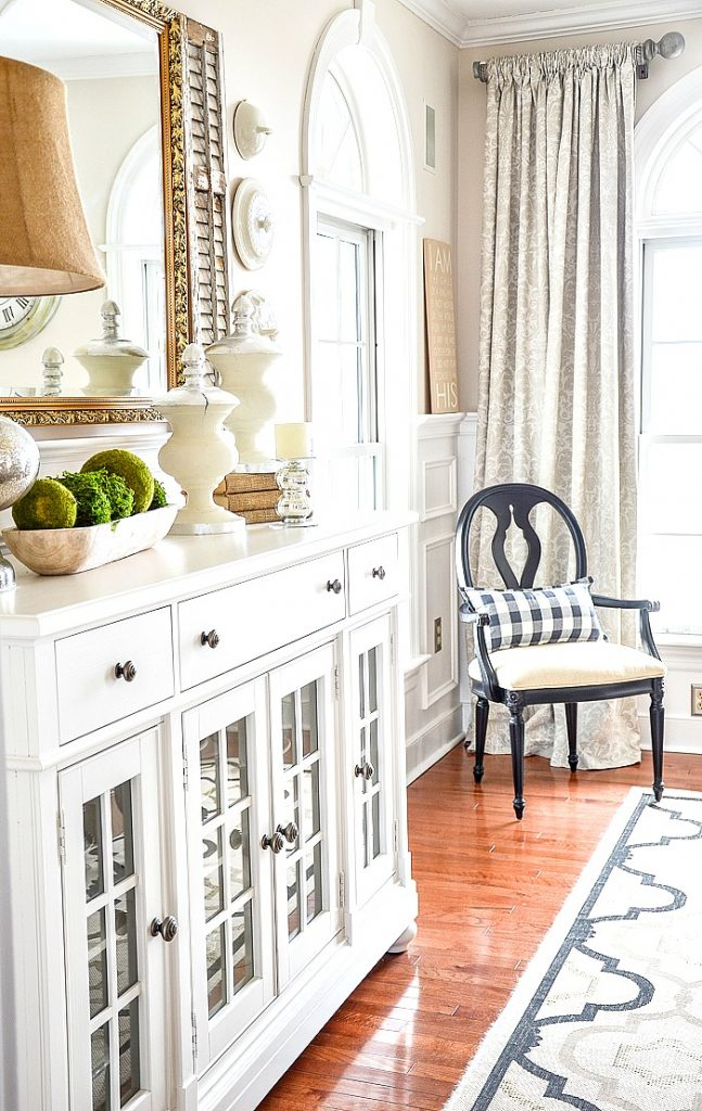 dining room image with buffet and accent chair