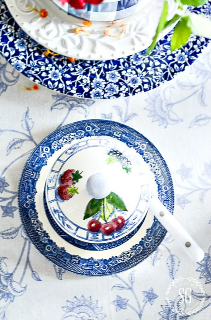 pretty blue and white dishes on a blue and white tablecloth